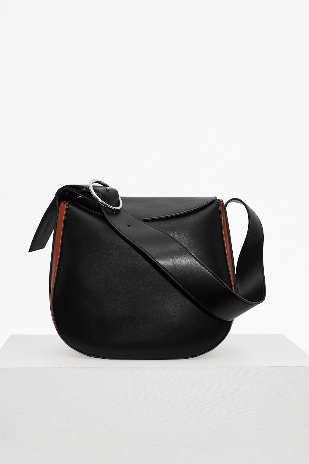french connection female oversized buckle moon faux leather bag